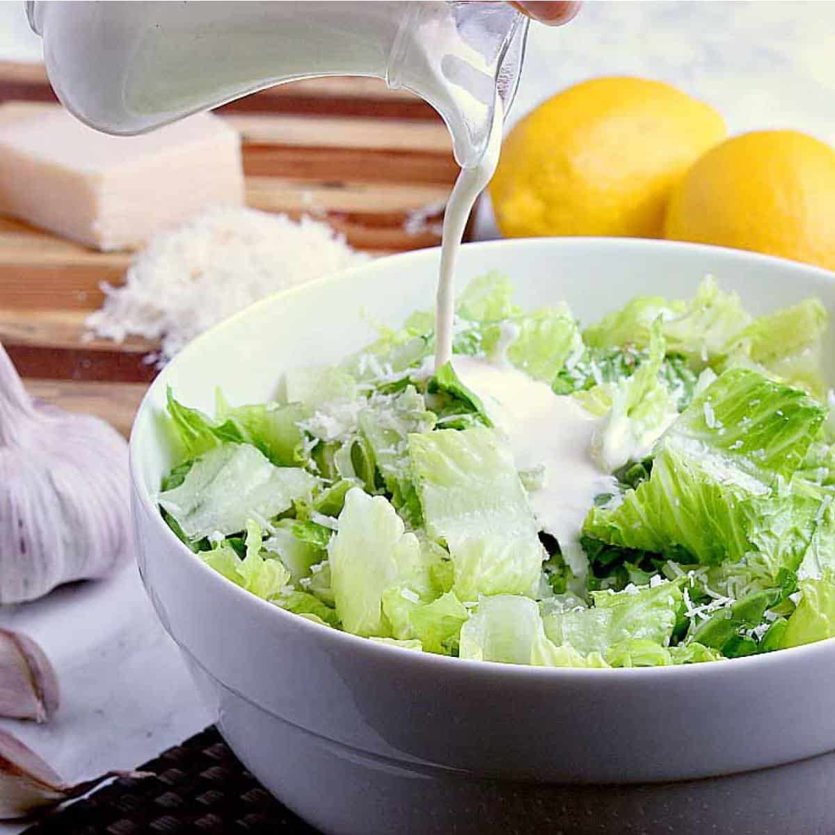 Creamy Caesar Dressing without Anchovy Paste. Extra creamy caesar dressing loaded with parmesan, garlic and lemony freshness. A cook book essential, this dressing is sure to light up your taste buds!