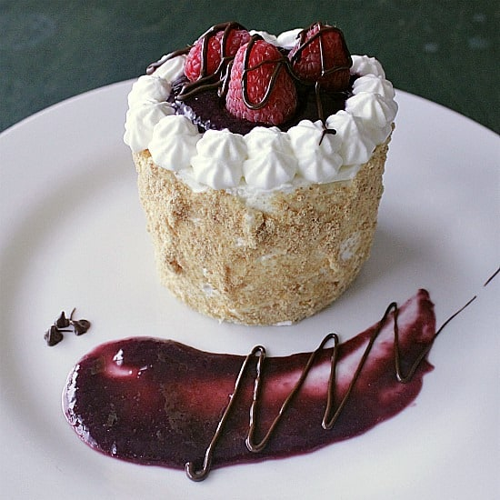 """Raspberry Cheesecake Cake for Two. Velvety cream cheese, sweet raspberry sauce and chocolate covered raspberries tie together to create a 3"""" circle of creamy perfection. Try this recipe for cheesecake with raspberry sauce tonight!"""