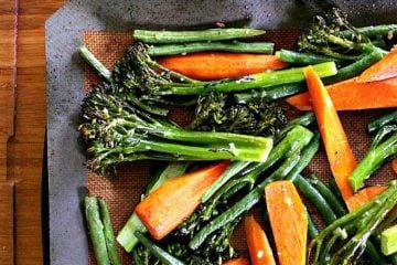 Roasted Broccolini, Green Beans and Carrots. These roasted vegetables are packed with flavour and carry the perfect texture. Crisp broccolini, vibrant carrots, crunchy green beans and roasted garlic play together beautifully to create an epic side dish that knows no bounds.