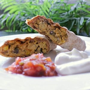 Mexican Breakfast Burritos. Fully loaded breakfast wraps with taco seasoned ground beef, jalapeños, red onion, black beans, chipotle mayo and more! Perfect for breakfast on the go!