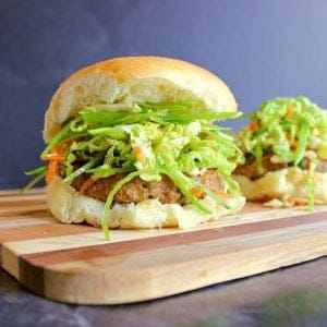Two asian turkey burgers loaded with an asian slaw.