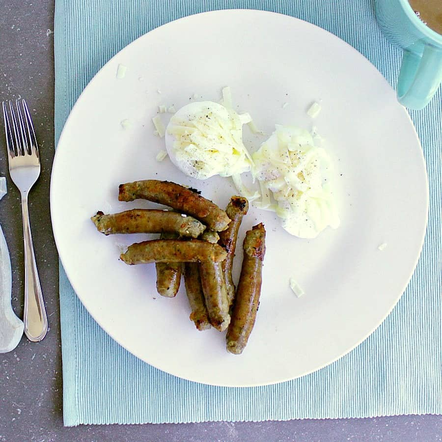 Plate with maple sausage links and poached eggs.