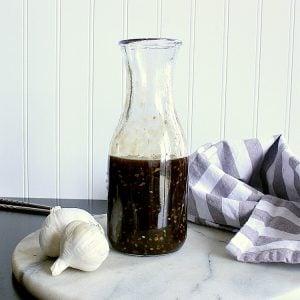 Jar of low carb teriyaki sauce on a marble cutting board.