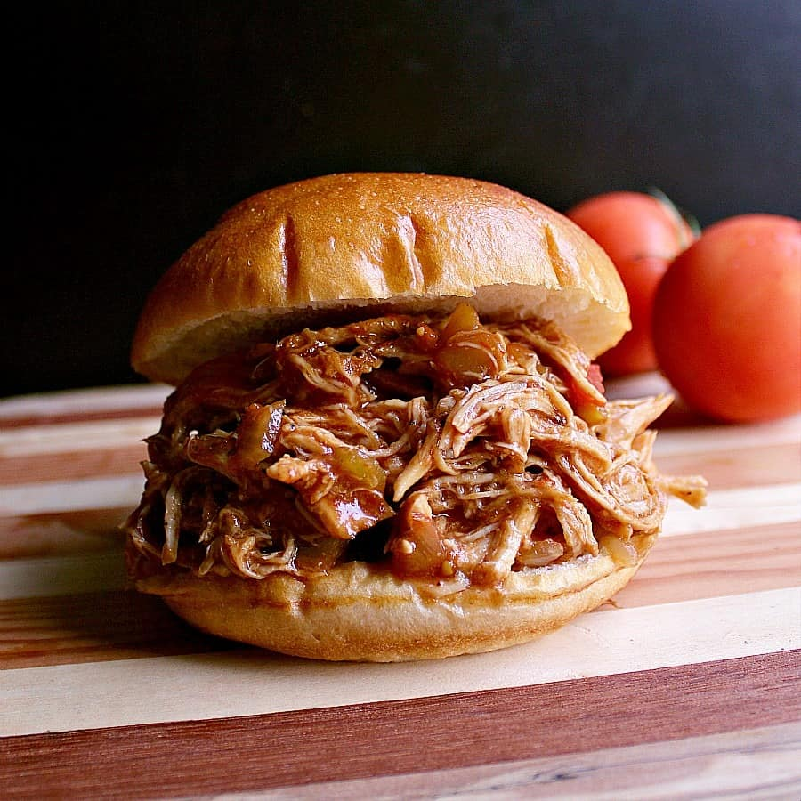 Pulled chicken sandwich made with salsa barbecue chicken thighs.