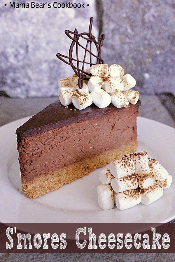 Bring in the summer with this s'mores cheesecake! Graham crumb crust, chocolate cheesecake with ganache topping, finished off with toasted marshmallows. #cheesecake #chocolate #smores #dessert #mamabearscookbook