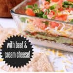 A clear serving dish with 7 Layer Keto Taco Dip. Texts read: Mama Bear's Cookbook, with beef & cream cheese!, Keto Taco Dip.