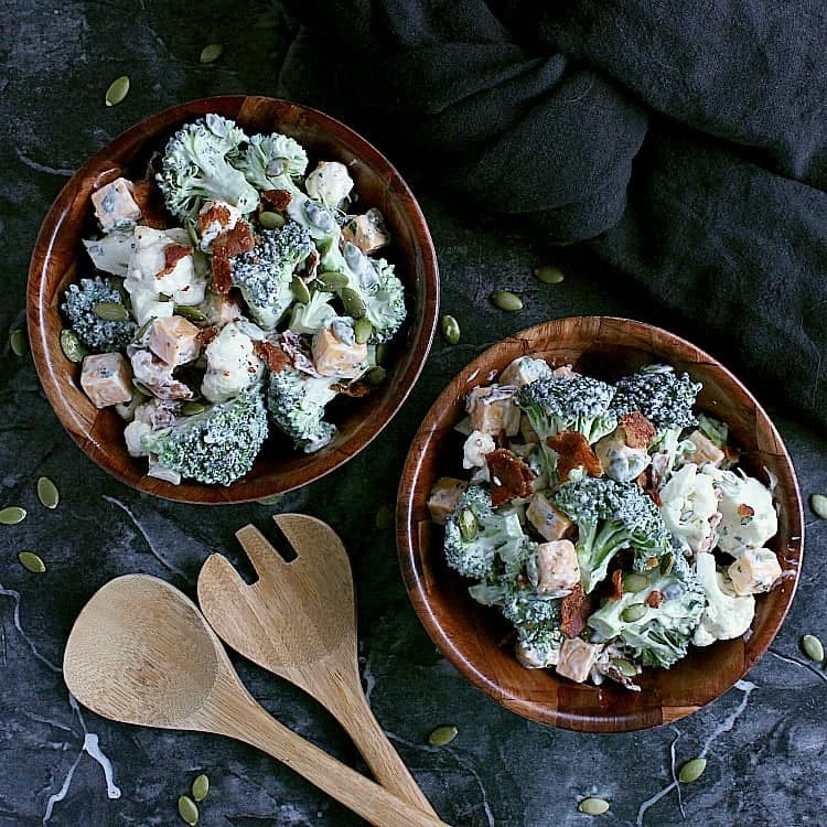 Two bowls of ranch cauliflower broccoli salad with bacon and cheese.
