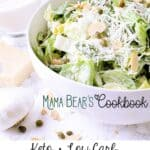 A white bowl with Keto caesar salad garnished with fresh parmesan cheese. Texts read: Mama Bear's Cookbook, Keto • Low Carb, Caesar Salad