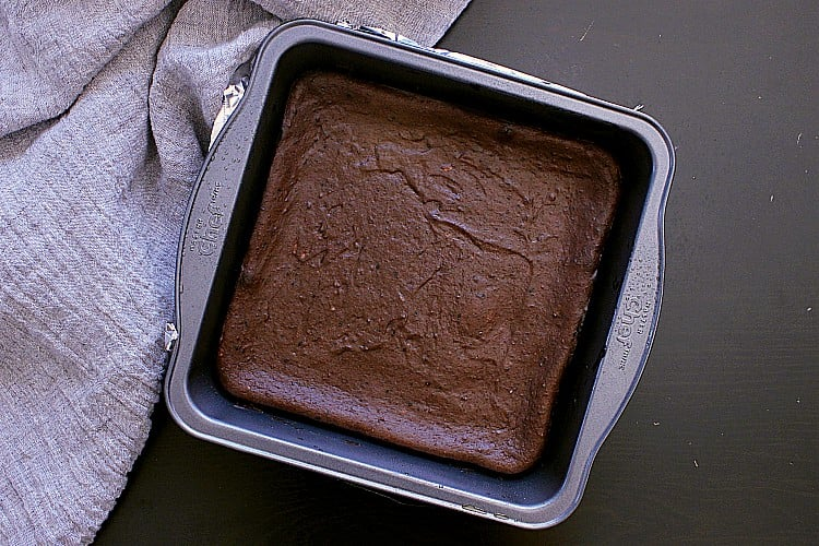 Keto chocolate brownie, fresh from the oven, left in the baking dish to cool.