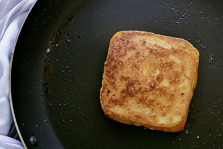 Keto Grilled Cheese, bread is toasty and cheese is melty, ready to be removed from the skillet and devoured!