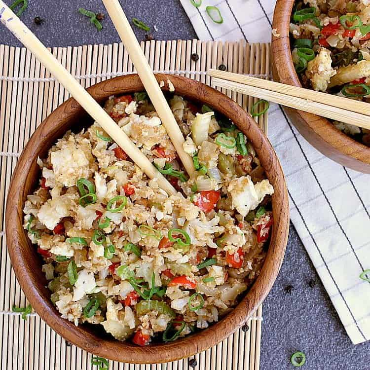 Two bowls of cauliflower fried rice.
