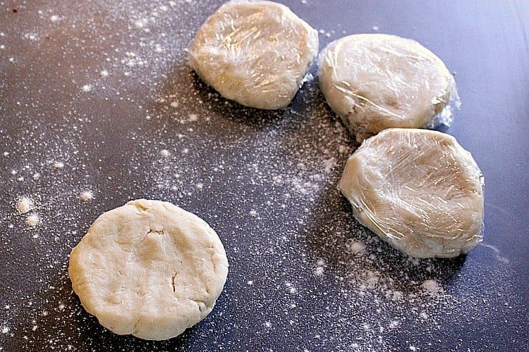 Four pie crust disks.