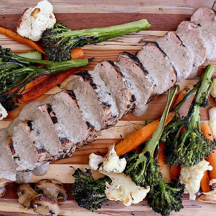 Juicy pork tenderloin with Keto Mushroom Sauce and Roasted Vegetables.