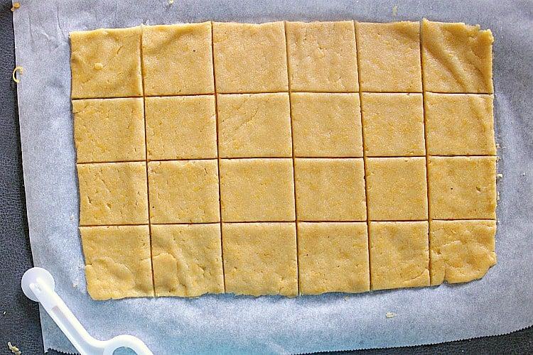 Cracker dough cut into 24 squares.