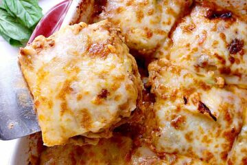 baking dish with cabbage lasagna, one slice removed.
