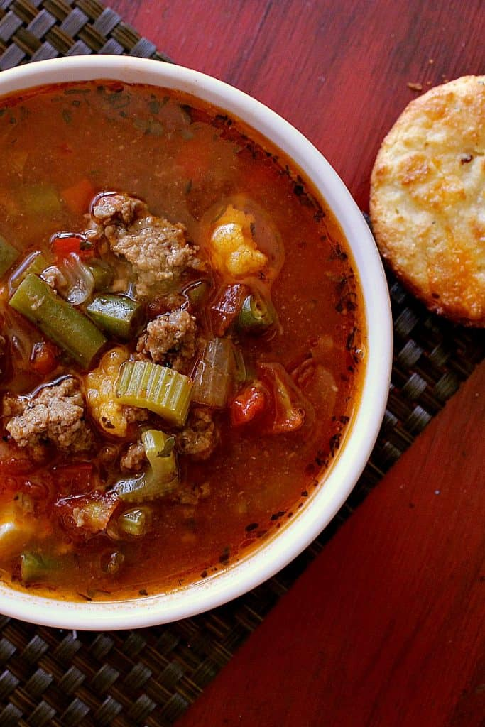 Bowl of low carb hamburger soup with a low carb biscuit.