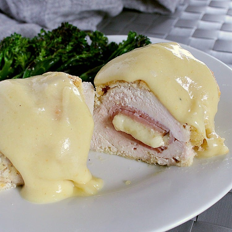 Keto chicken cordon bleu sliced in half to show the ham and melted cheese inside.