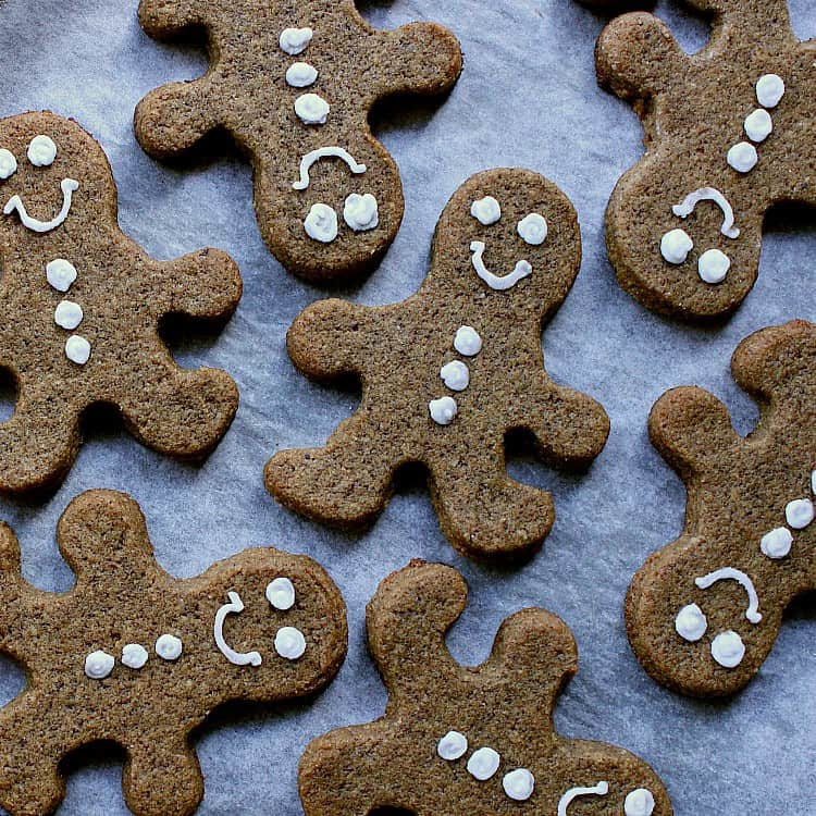 baking sheet with decorated gingerbread men.