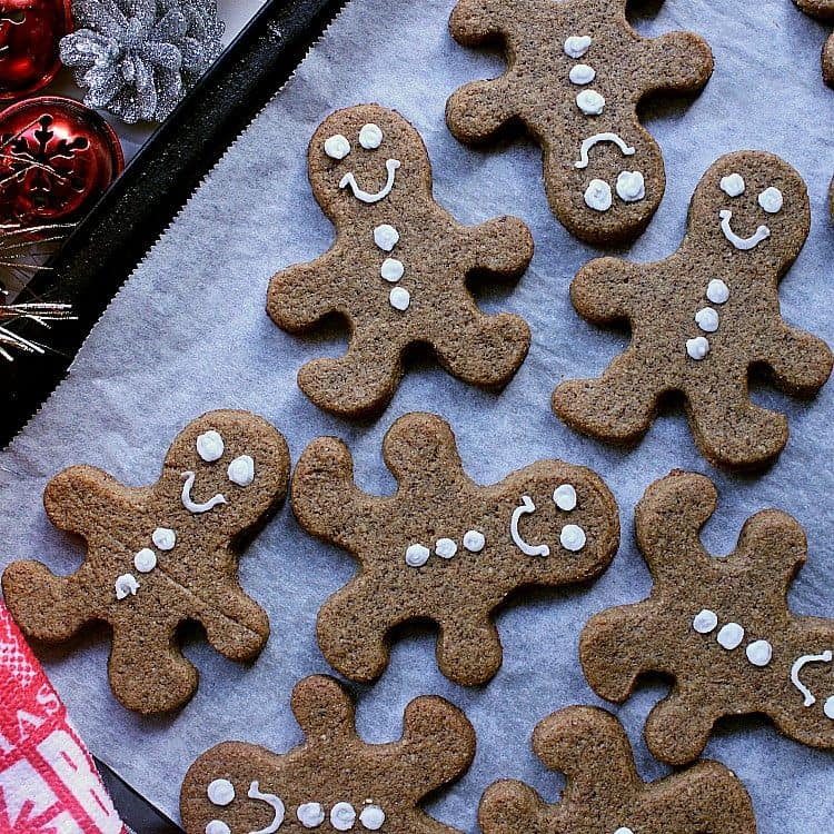 Baking sheet with decorated keto gingerbread cookies.