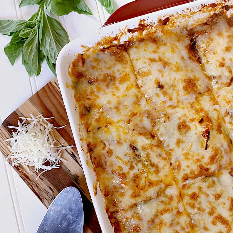 Freshly baked low carb cabbage lasagna, sliced into 12.