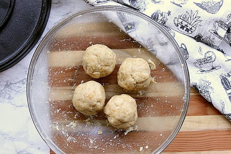 almond flour dough divided into 4 balls.