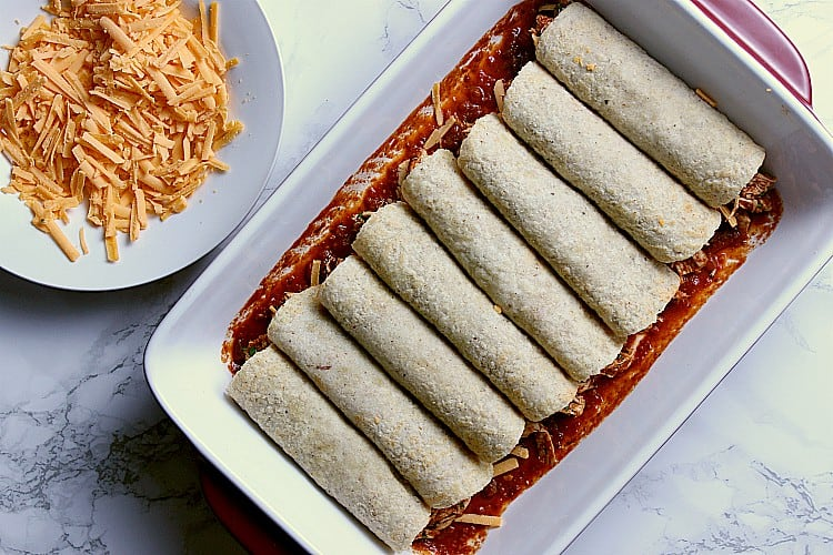 baking dish with 8 keto enchiladas