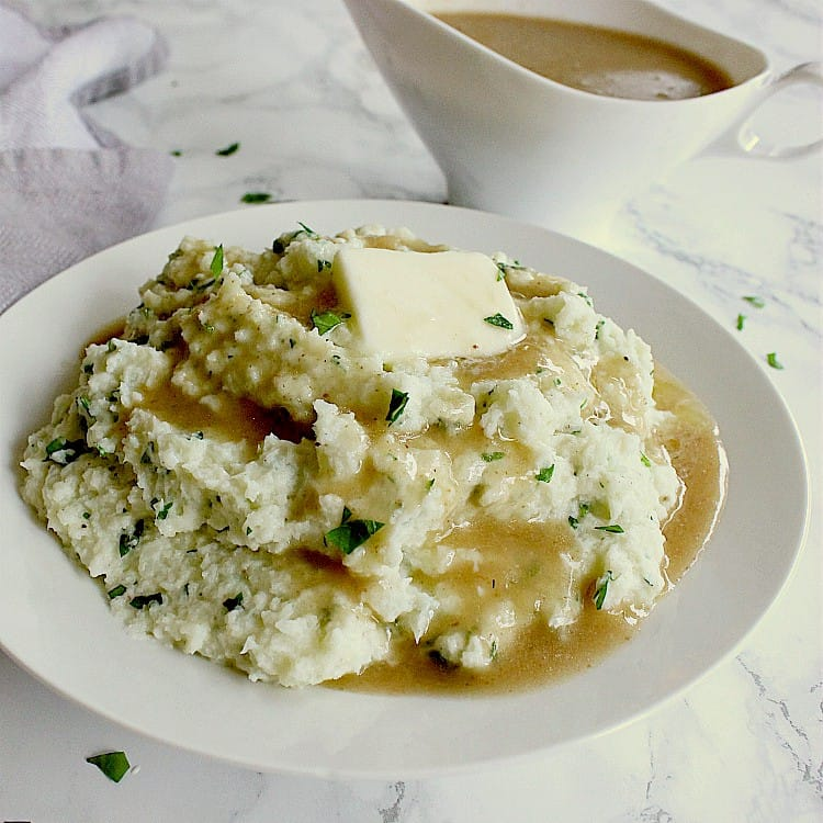 keto mashed cauliflower drenched in keto gravy.