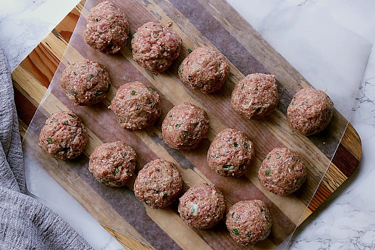 15 meatballs formed and ready to be fried.