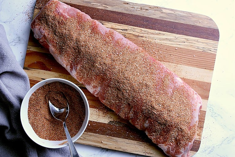 Uncooked ribs covered in low carb rib rub.