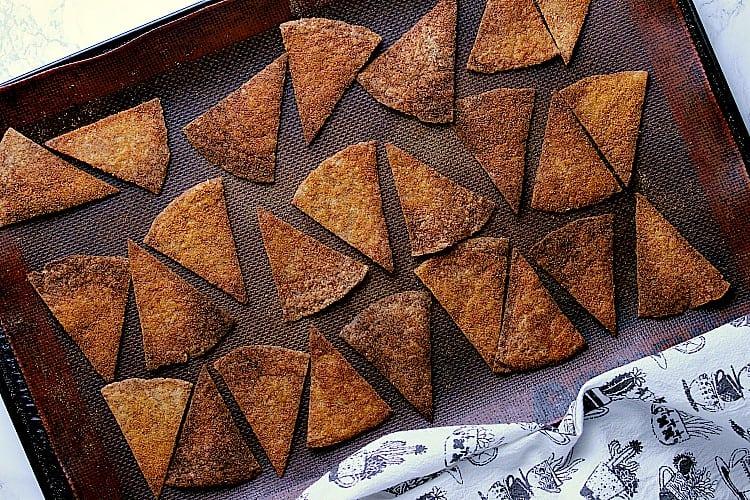 Baking sheet with hot nacho keto chips.