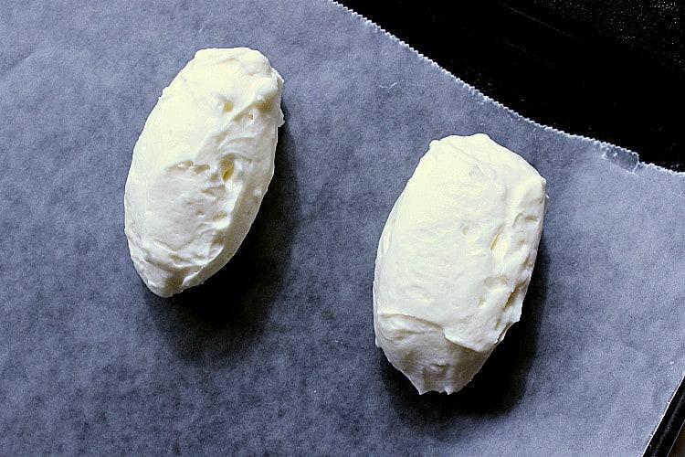Two egg shaped cheesecake balls.