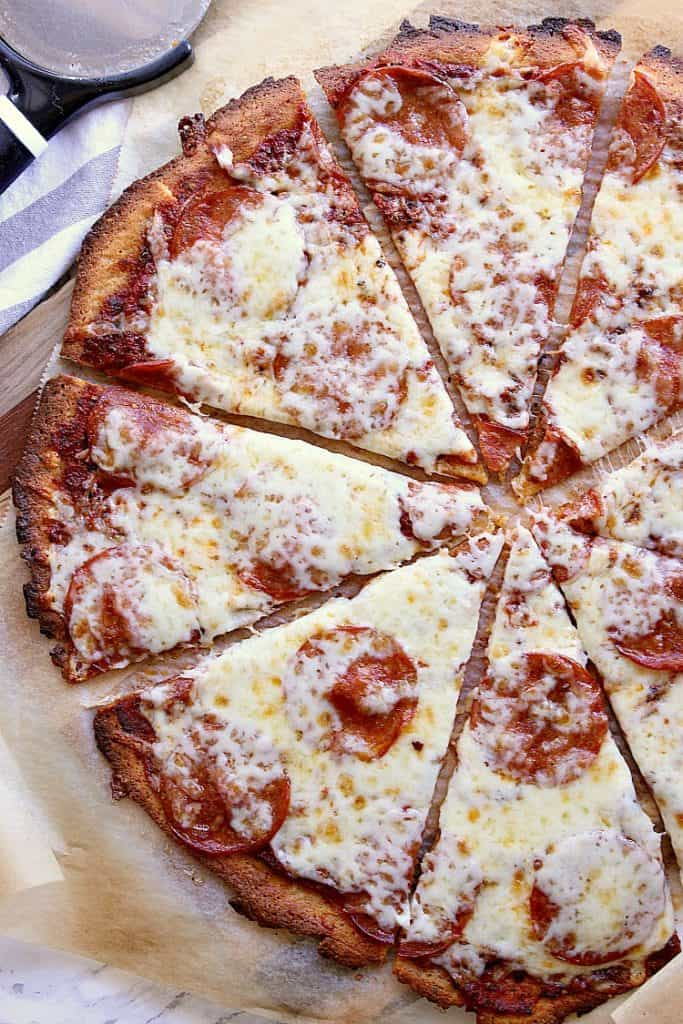 Keto pepperoni pizza sliced into 8.