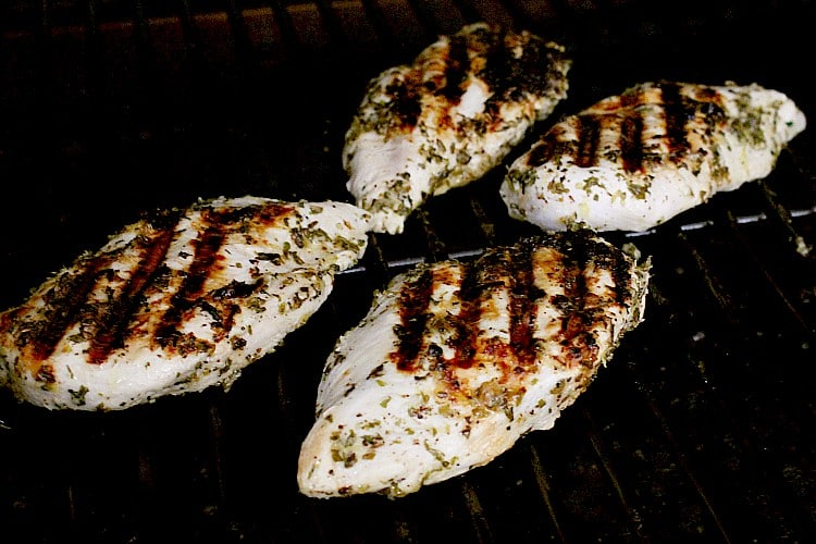 Grilled keto greek chicken breasts on the grill.