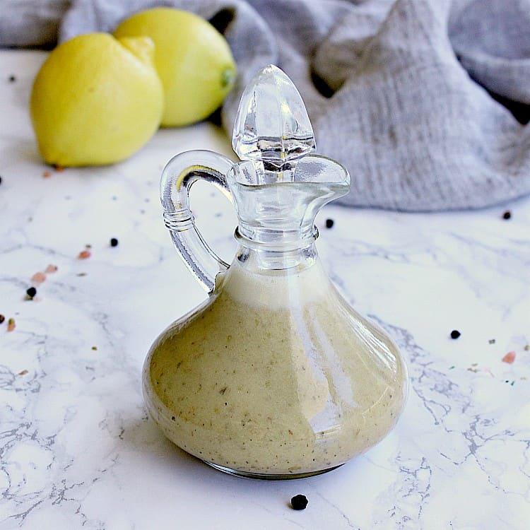 Dressing jar filled with keto greek dressing.