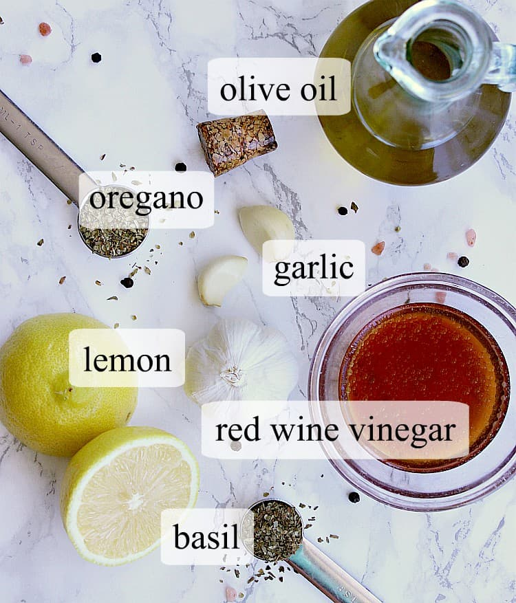 All of the ingredients needed to make a keto greek dressing.