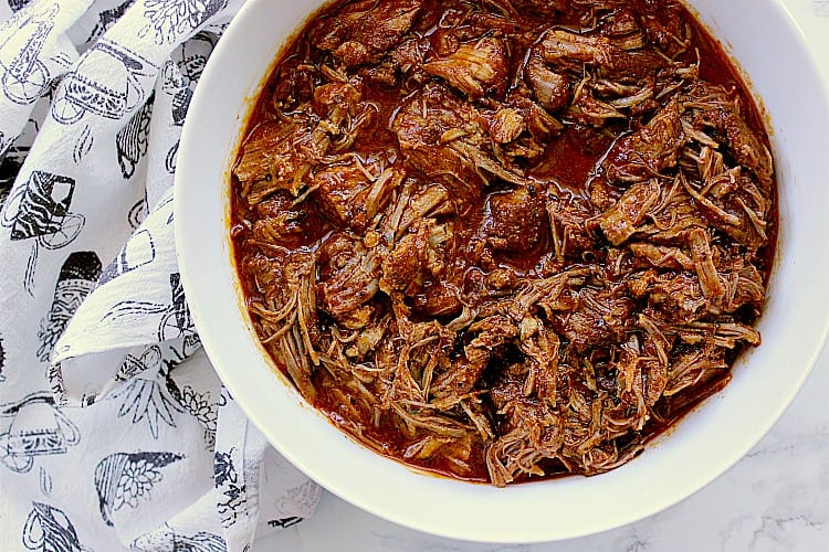 Bowl of pulled pork, smothered with bbq sauce and ready to be served.