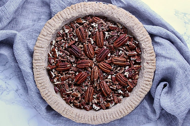 Pie crust filled with pecans.