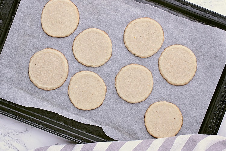 Freshly baked Keto Shortbread Cookies, cooling on the baking sheet.