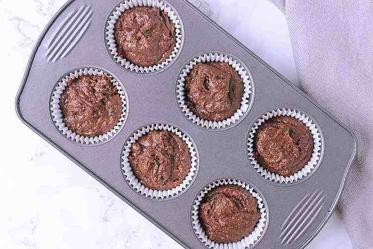 A 6 tin muffin tray with filled liners.