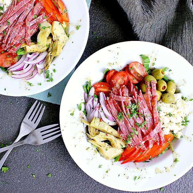 Two plates with Keto Antipasto Salad.