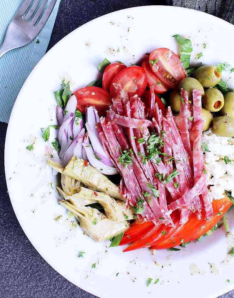 A white bowl with Keto Antipasto Salad.