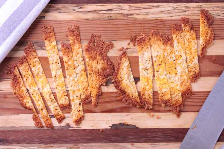 Cutting board with cheese strips
