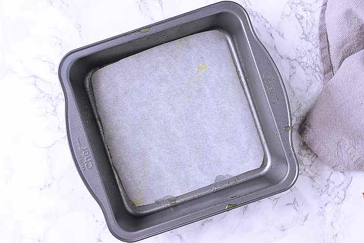 A baking dish with parchment paper.
