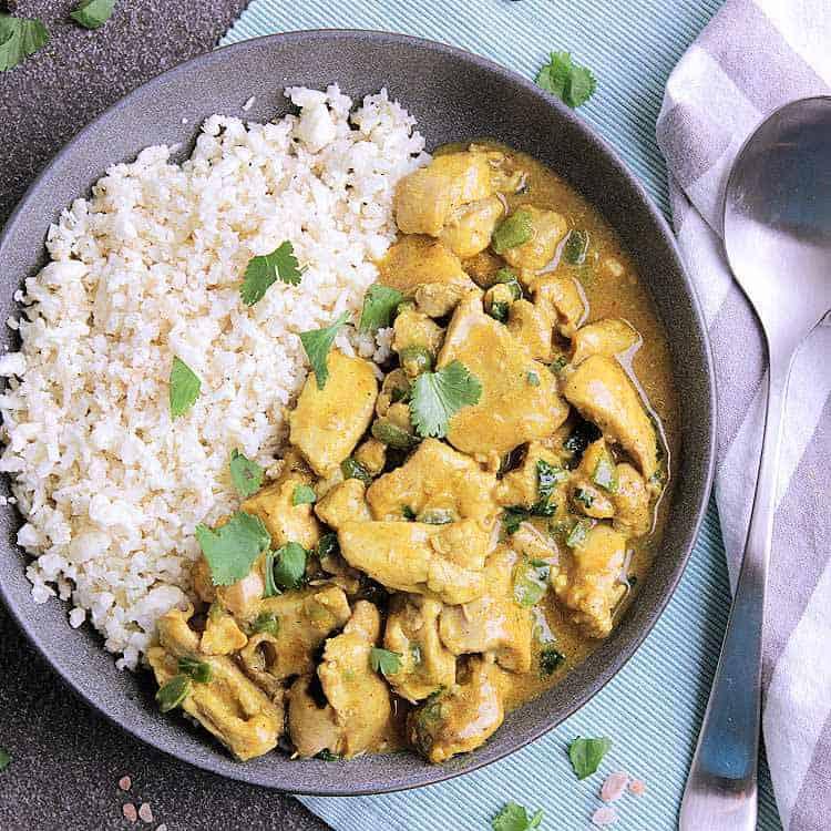 Bowl of Keto Thai Curry Chicken with Cauliflower Rice.