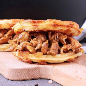 A chaffle loaded with Keto Pulled Chicken.