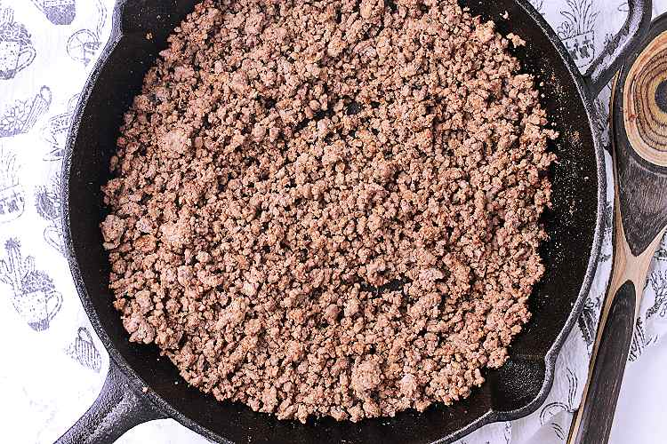 Cast iron skillet with taco seasoned beef.