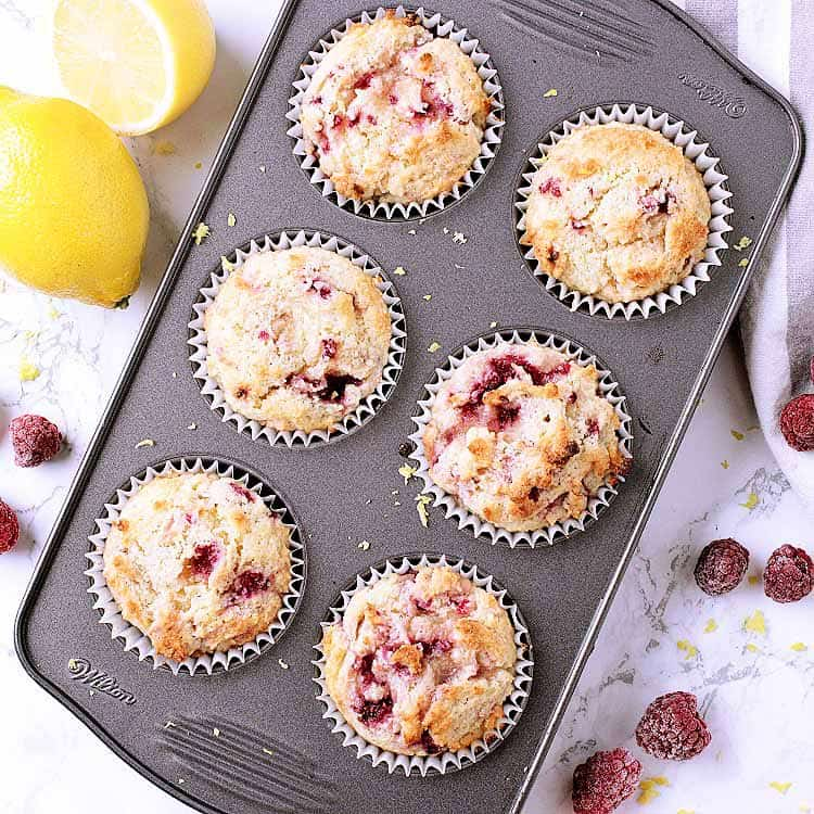 A muffin tray with 6 Keto raspberry muffins.
